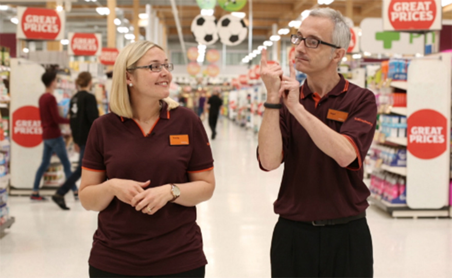 Sainsbury's collegues communicate with sign language
